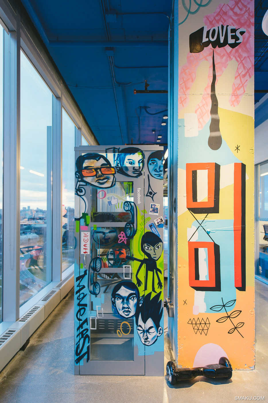 A booth and pillar covered in artwork at Facebook Canada's headquarters.