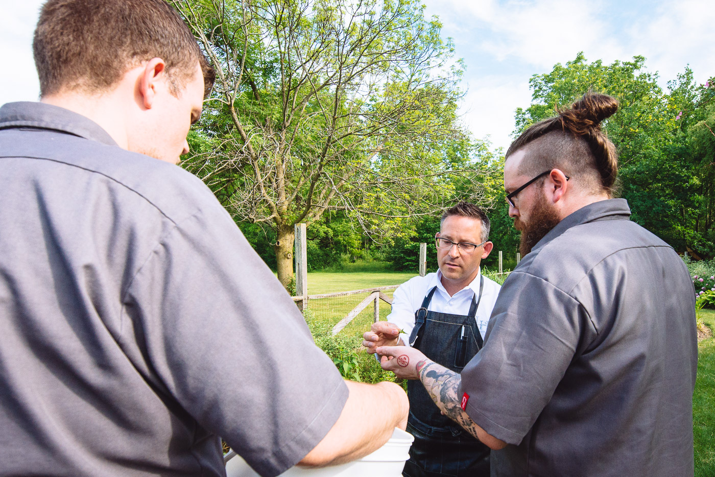 Chef Bangerter and Chef McDonald picking herbs in the Langdon Hall garden for the night's menu.