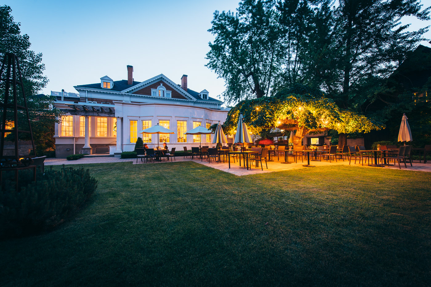 Back patio area of Langdon Hall during twilight.