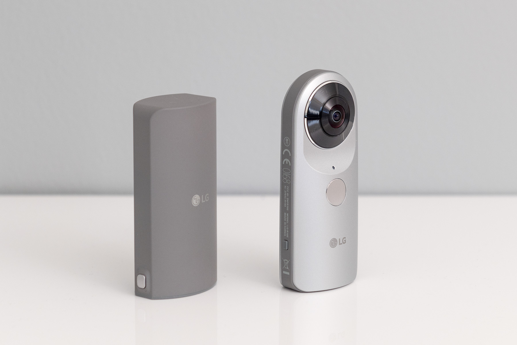 The LG 360 Cam and its cover detached.