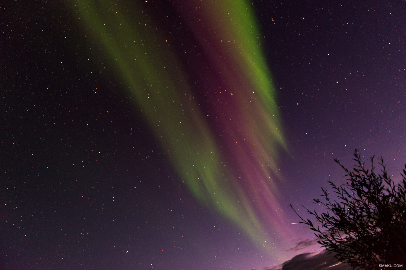 The sky has a deeper purple hue to it, with slightly different hues of the Aurora Borealis.
